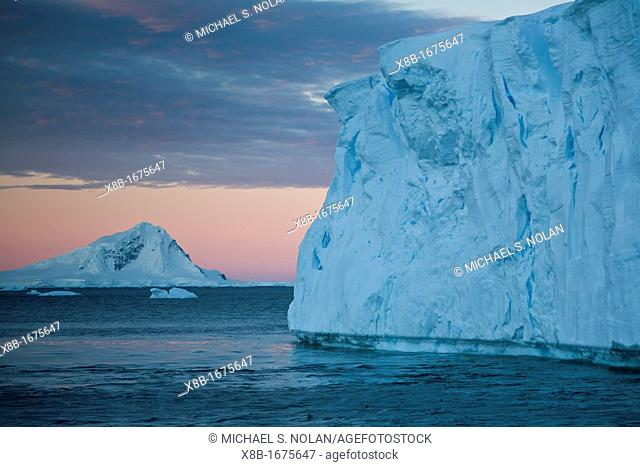 Views of tabular icebergs near Adelaide Island at sunset in Antarctica