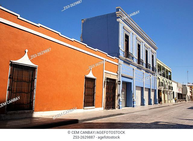 Street scene from the town center with colorful colonial buildings in the foreground, Merida, Yucatan Province, Mexico, Central America