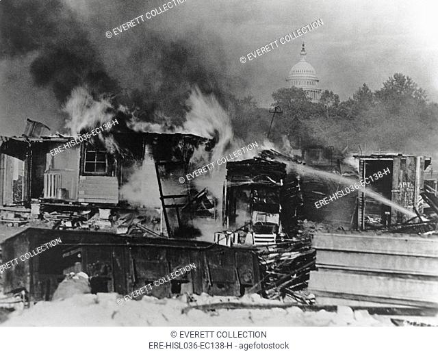 Bonus Army shacks on fire at Anacostia flats, Washington, D.C. Army troops broke up the Bonus Marchers protest and burnt their shanty town on July 29, 1932