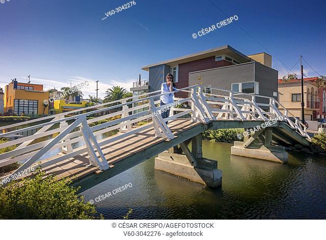 Model posing on the bridge in Venice Channels- Los Angeles (California)