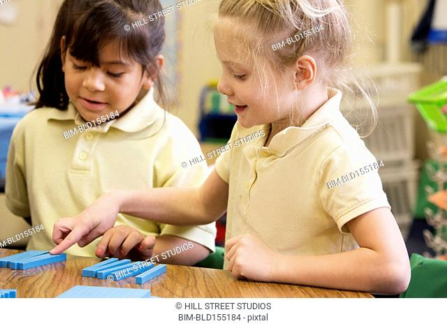 Students counting in classroom