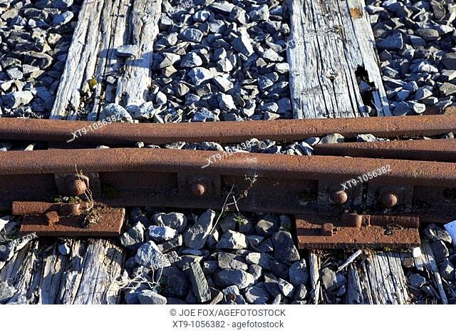 old rusted railway line split tracks and sleepers in Charlestown county mayo republic of ireland