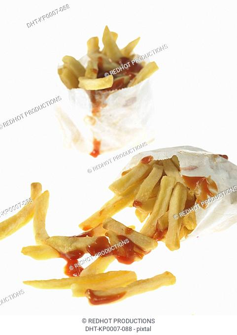 French fried Chips and Tomato Sauce in take out packaging