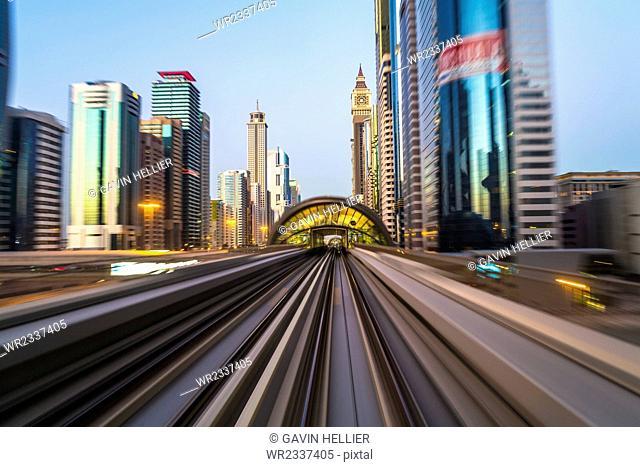 POV on the modern driverless Dubai elevated Rail Metro System, running alongside the Sheikh Zayed Road, Dubai, United Arab Emirates, Middle East
