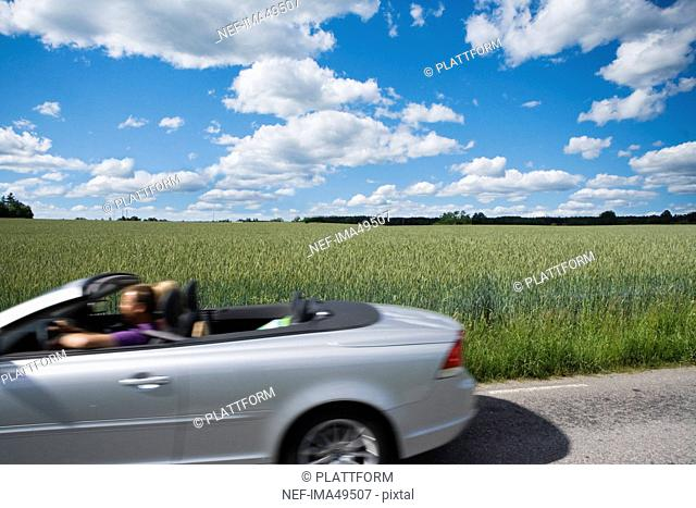 Two people in a car, Sweden