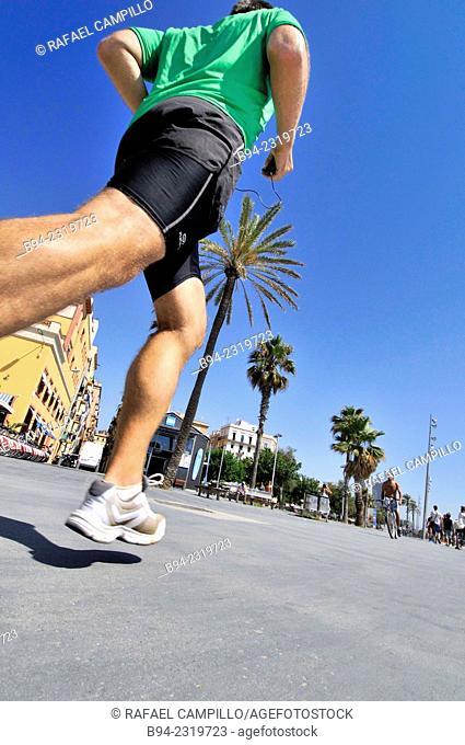Urban athlete running, Barcelona, Catalonia, Spain
