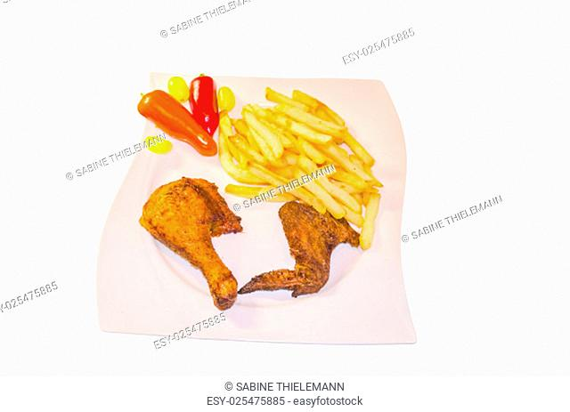 closeup of a plate with brown roasted rotisserie chicken and french fries against white background ..