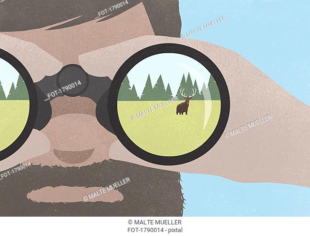 Reflection of moose in field in binoculars held by a man with a beard