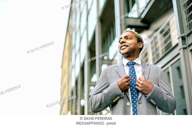 Portrait of a proud businessman, low angle view