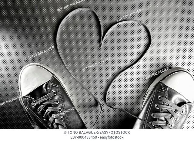 Laces of silver shoes, threads with heart valentines shape