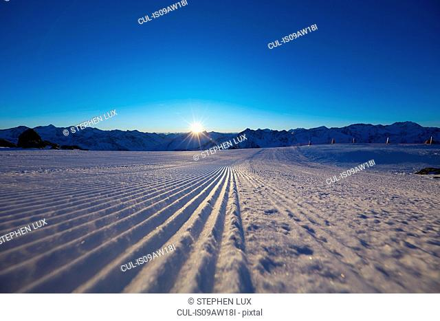 Snow covered field and sunset over mountains, Gaislachkogel, Soelden, Tyrol, Austria