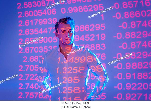 Businessman with projected financial data