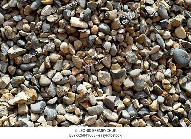 Background from small round crushed stone. A heap from a small pellet