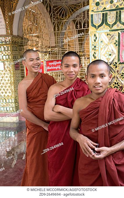 Three monks visit Mandalay Hill to practice their English