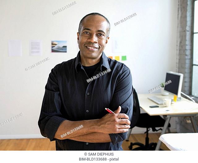 African American architect smiling in office