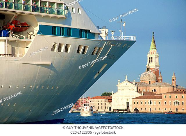 Tourist Cruise liner and vaporetto sailing on Bacino di San Marco, Venice, Italy