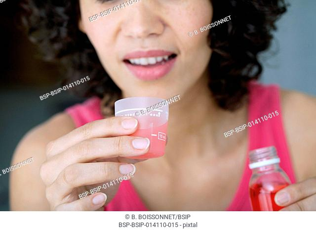 Woman having a mouthwash