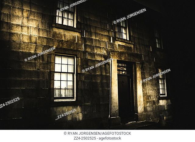 Vintage exterior photograph of a creepy dark building built between 1825 and 1840 in colonial Australia. Richmond Gaol facade, Tasmania