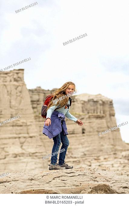 Caucasian girl standing on desert rock formations