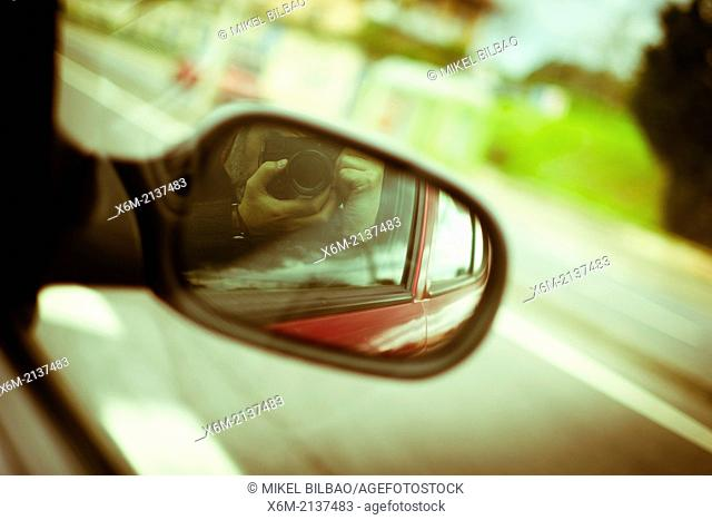 Rear-view mirrow and road
