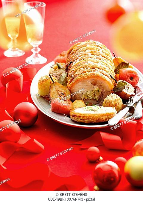 Plate of stuffed roast pork and fruit