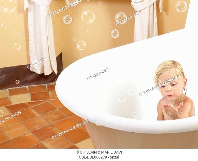 Little girl taking a bath bubbles