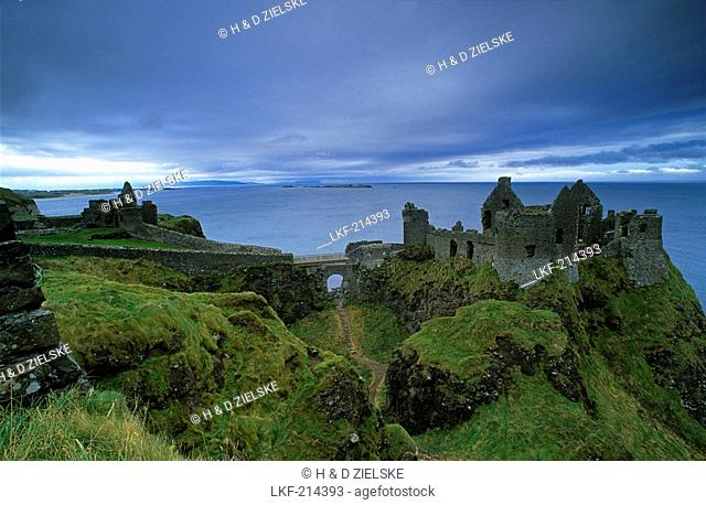 The ruins of Dunluce Castle on shore, County Antrim, Ireland, Europe