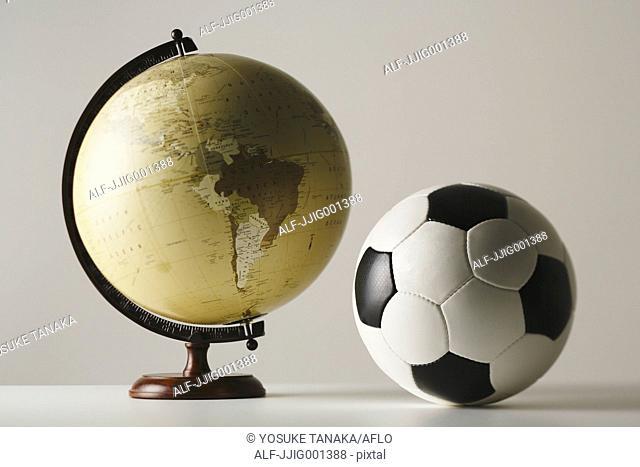 Soccer ball and globe