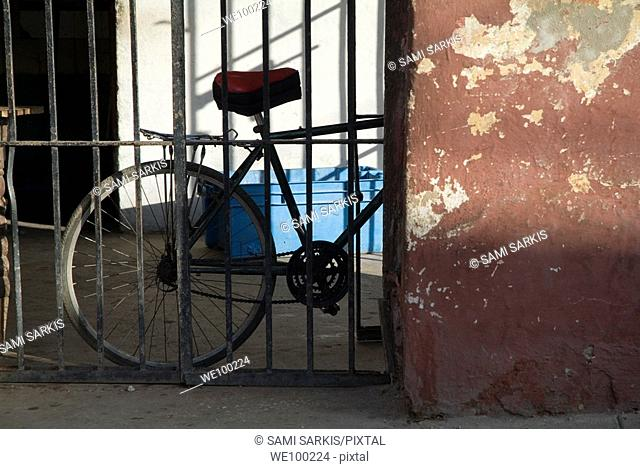 Old bicycle parked against a wall, Trinidad, Sancti Spiritus, Cuba
