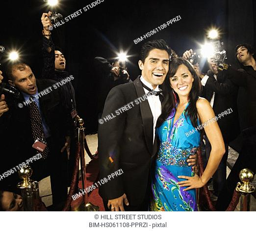 Celebrity couple smiling on the red carpet