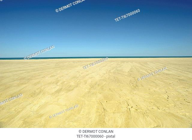 Sand plateau and horizon over water