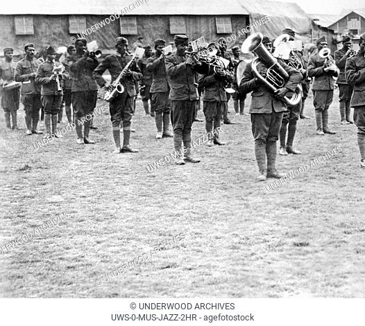 France: c. 1918.Members of the 369th Infantry Regiment band under the direction of Lt. James Reese Europe. The 369th was also known as the Harlem Hellfighters