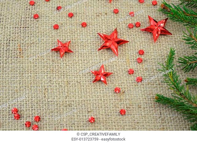 Red Christmas stars and a fir tree branch