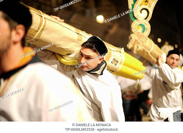 Italy, Sicily, Catania, men carrying candle during Sant'Agata Feast the Patron Saint of the city
