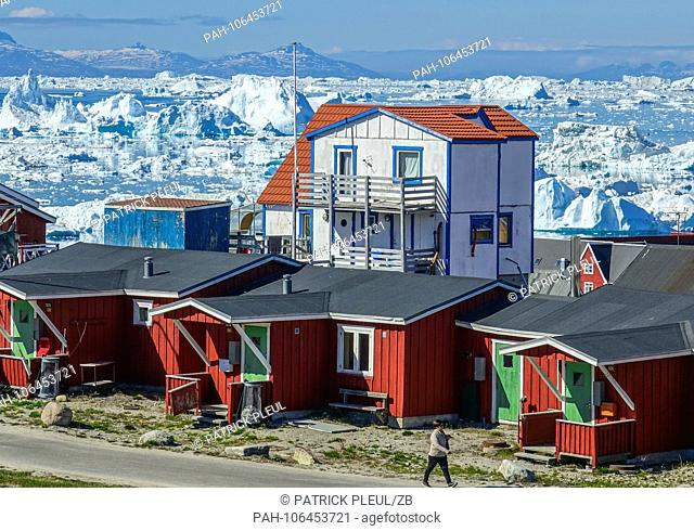 24.06.2018, Gronland, Denmark: Colorful houses of the coastal town of Ilulissat in western Greenland. The city is located on the Ilulissat Icefjord
