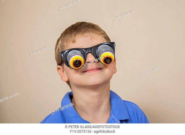 Young boy wearing funny glases