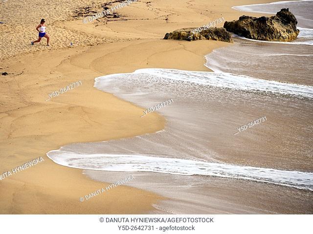 Europe, Portugal, Southern Portugal , Algarve region , Faro district , Lagos, Praia Batata - Batata beach, single woman excercising at the seaside