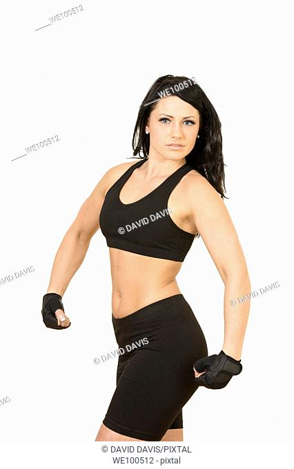 Caucasian teenager posing in a work out outfit on white background