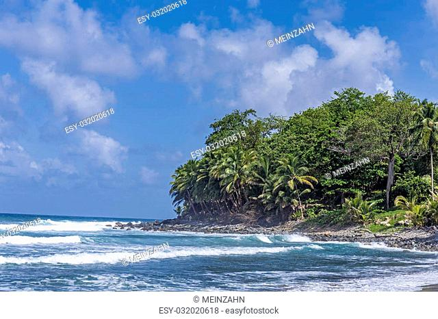 scenic ocean landscape in Dominica with huge waves and view to the cliffs
