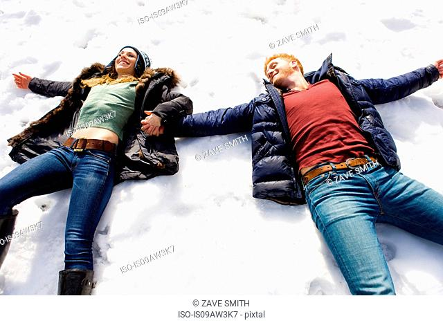 Couple lying down in snow