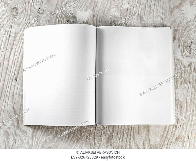Blank opened book on wooden background. Top view