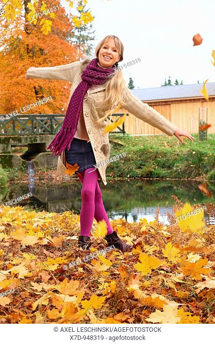 Woman walking in autumn landscape