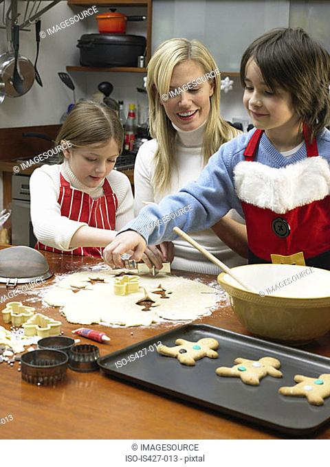 Mother and children making cookies