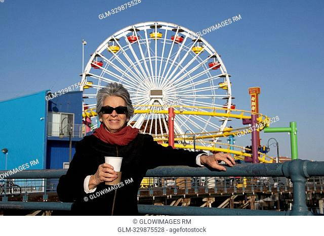 Woman holding a drink in an amusement park, Santa Monica Pier, Santa Monica, Los Angeles County, California, USA