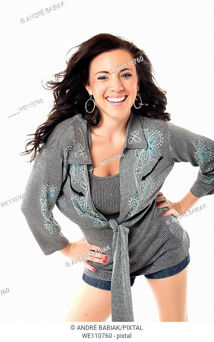 Young woman in casual outfit posing and smiling