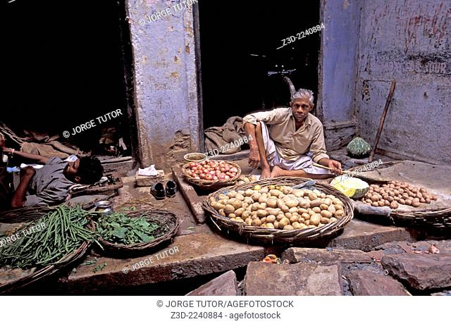 Vegetable Vendors in narrow old city alley Varanasi, Uttar Pradesh, India