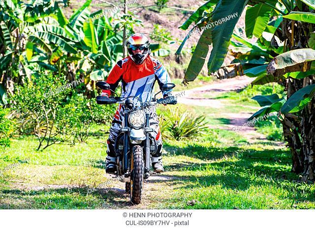 Biker exploring countryside, Nan, Thailand
