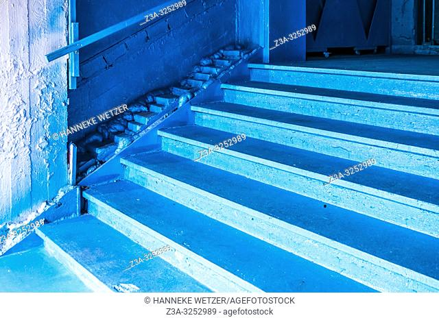 Blue stairs and blue wall