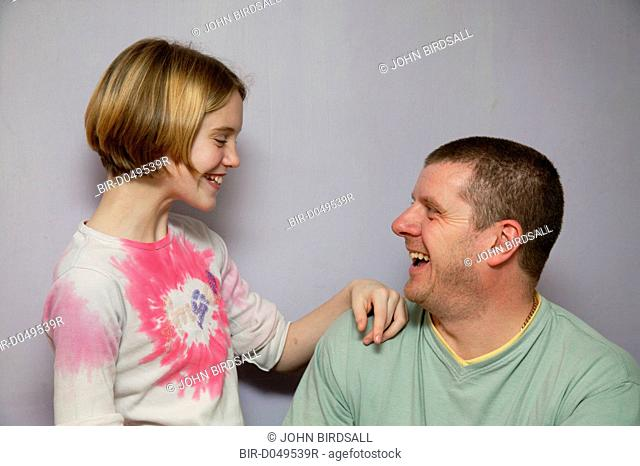 Father and daughter laughing together
