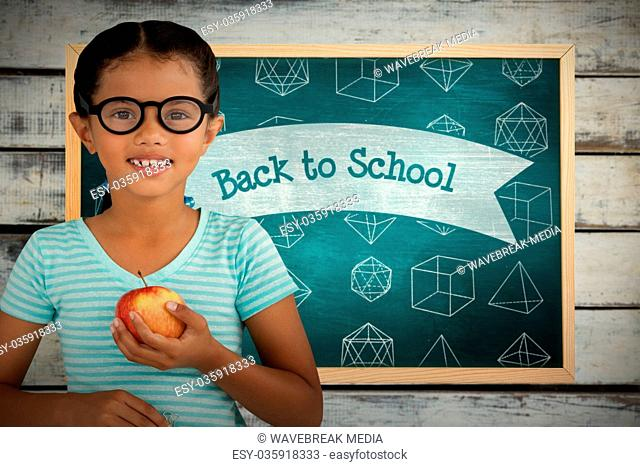 Composite image of portrait of smiling girl wearing eyeglasses holding apple